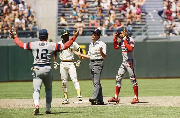 Neither Chicago White Sox fielder Julio Cruz &#40;12&#41; and Ozzie Guillen &#40;13&#41; or Oakland As base runner Tony Phillips, center, seem to believe second base umpire Tim Tschidas call of safe after Phillips stole second base during the fourth inning of their game, Sunday, June 30, 1986, Oakland, Calif. The White Sox ended up on top beating the As 6-5 in 10 innings.  <span class=meta>(AP Photo&#47;Bill Beattie)</span>